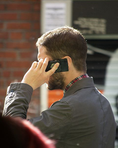 240px-Man_speaking_on_mobile_phone