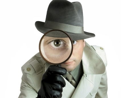 detective-with-magnifying-glass-resized-600